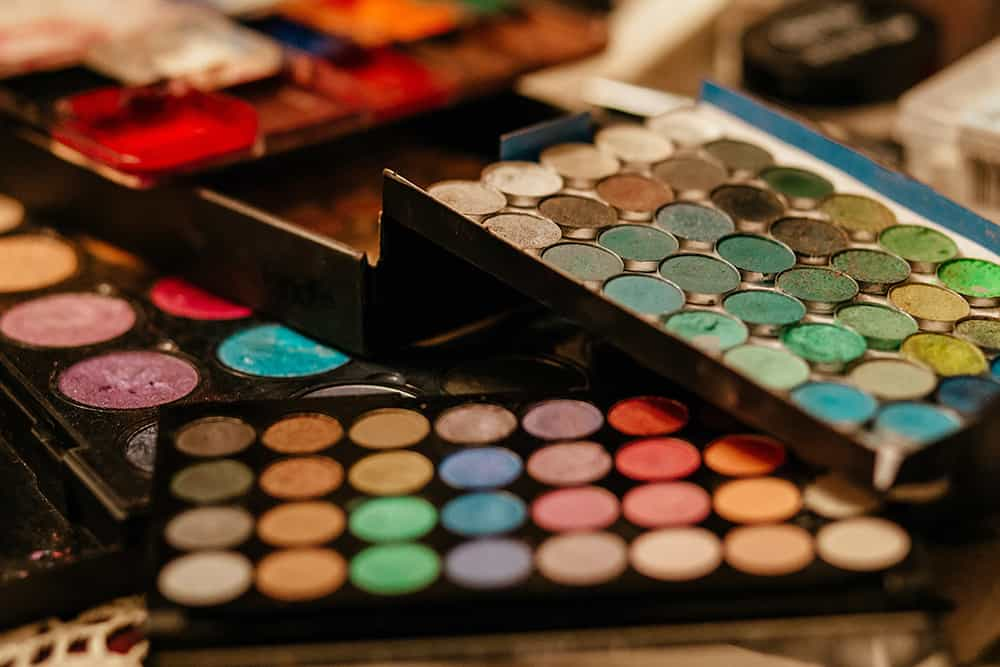 Large variety of colorful makeup compacts