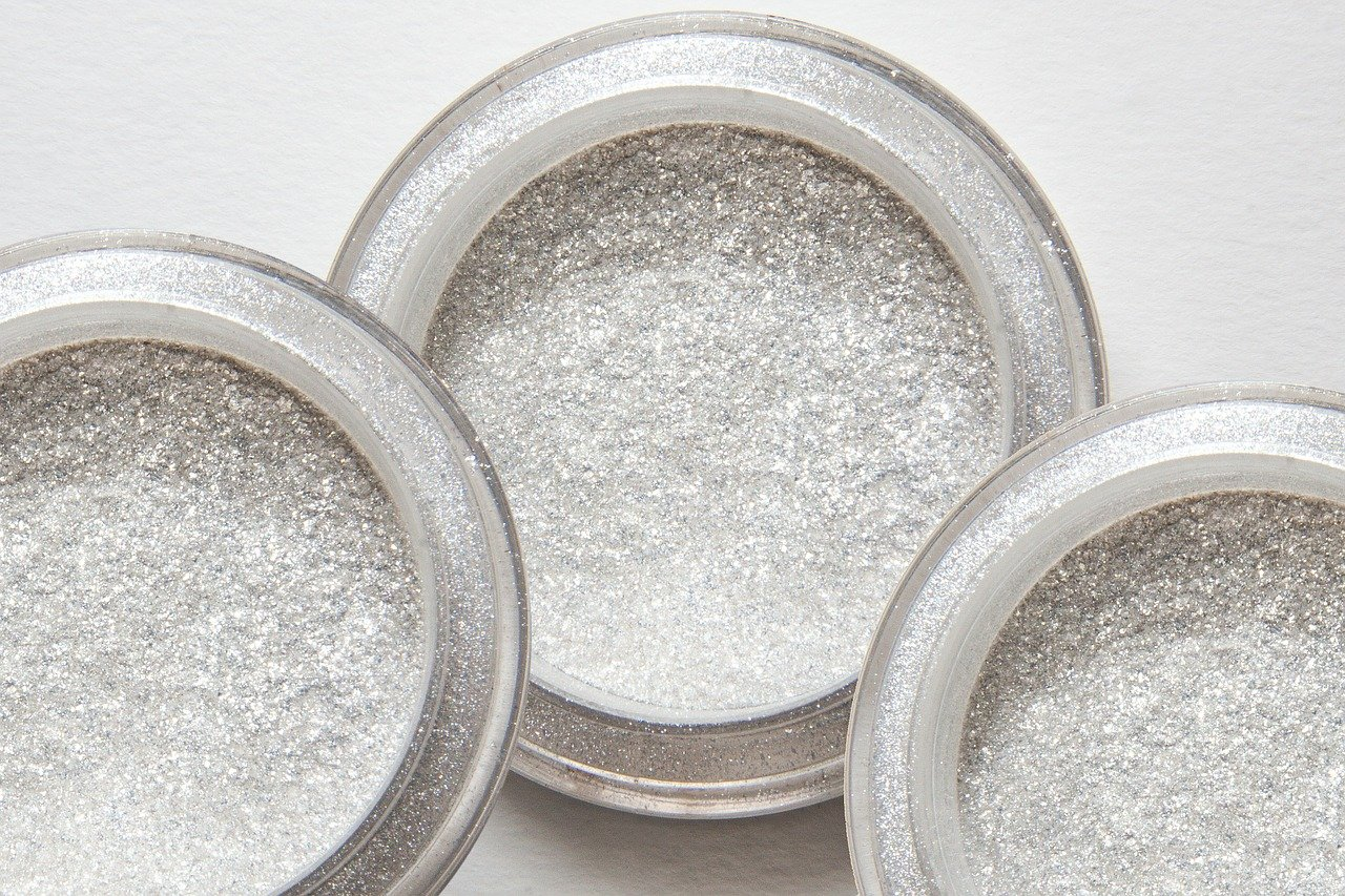3 bowls of glitter powder