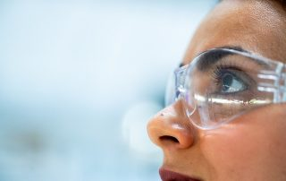 woman with lab goggles on